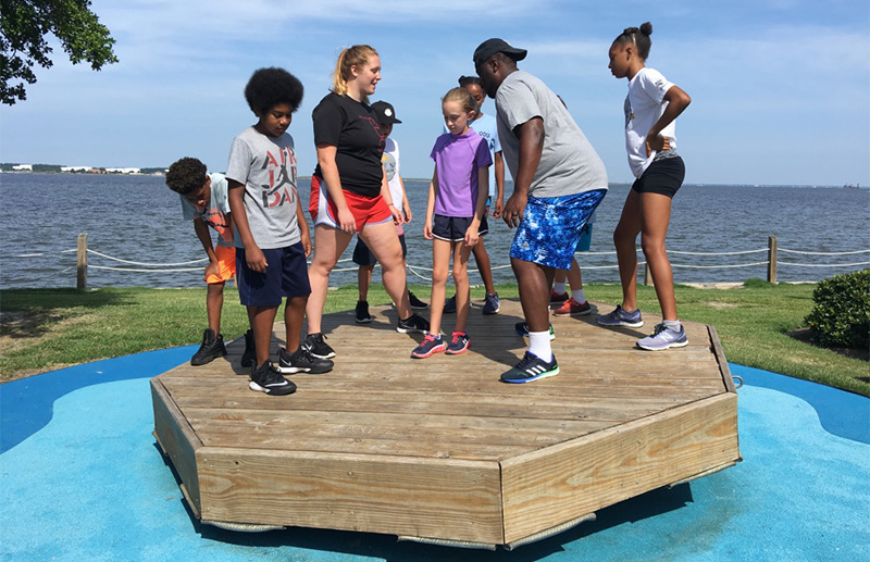 Campers and staff in a balance activity
