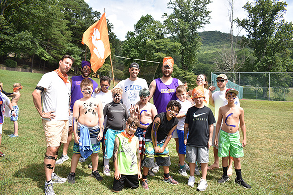 Campers posing with face and body paint