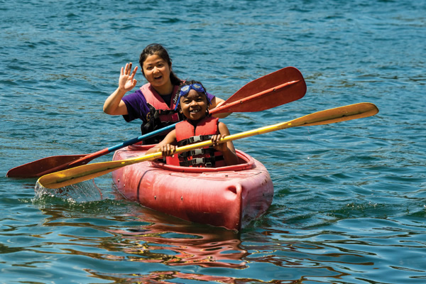 Camper and counselor in canoe