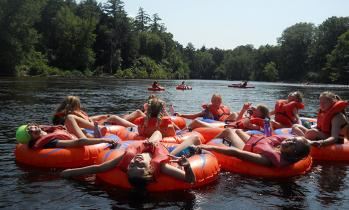 campers floating down river