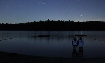 camp staff looking at night sky