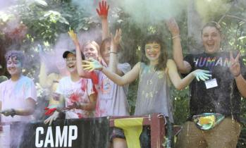 Campers throwing powder up in the air