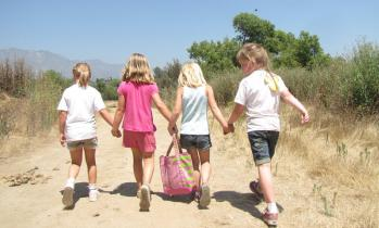 4 girls holding hands - Tom Sawyer Camps