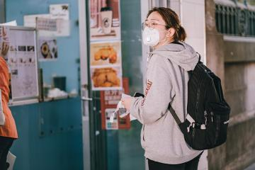 Student wearing mask in hallway