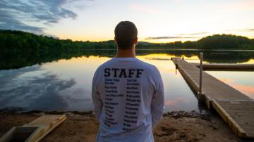 staff member looking out over lake