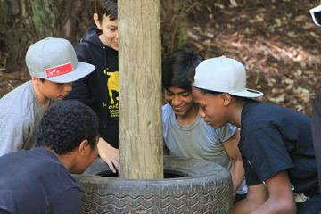 group of campers surround tires