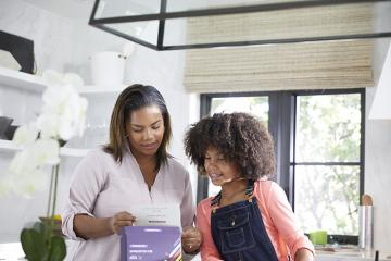 Mother and daughter reviewing test kit