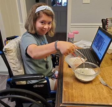 camper in wheelchair doing virtual camp activities