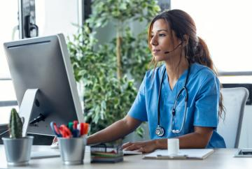 Nurse in front of computer at desk