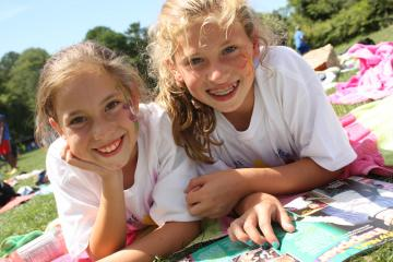 two girl campers smiling for camera