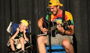Boy in wheelchair and staff with guitar - Victory Junction, Randleman, NC