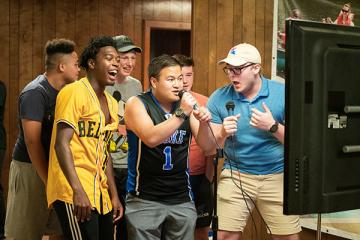 Camp staff singing karaoke