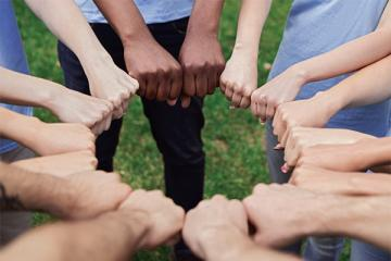 counselors hands in a circle