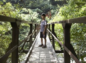 boy on bridge
