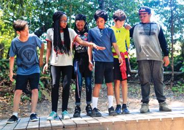 Campers working on a team-building activity