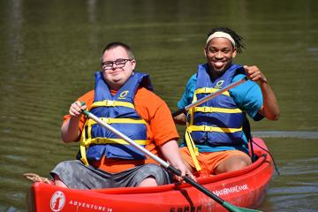 camper and staff canoeing