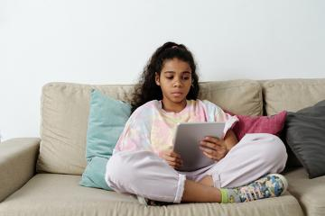 stock photo of girl reading tablet