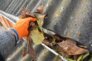 Cleaning debris from gutters