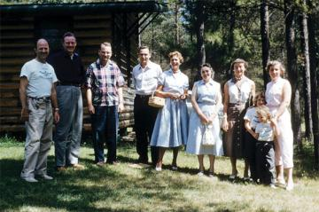 A photo of camp directors and families from the 1950s
