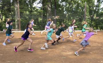 Campers racing each other on dirt path