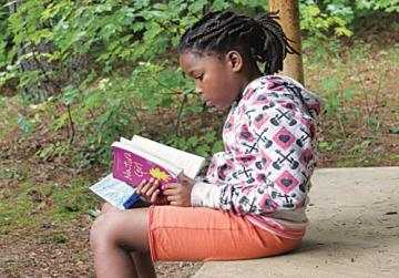 Girl reading on porch