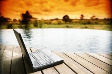 Laptop by lake