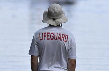 "Photo of waterfront staff with ""lifeguard"" in type on tshirt"