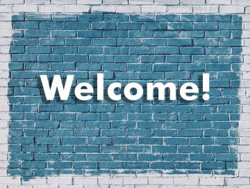 Welcome! on a brick wall