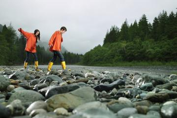 Individuals walking on river bed