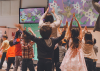 Kids exercise while following along to television